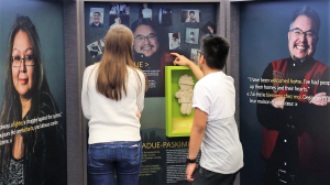 Photo of students looking at exhibit