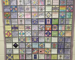 Photo of a wall mural of student led Lent art.