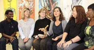 Photo of staff sitting in a restorative circle in a school.