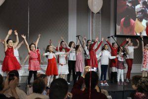 Photo of children singing on stage