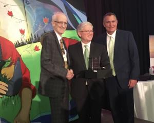 Photo of Trustee Curry (far left) receiving the 2018 OCSTA Trustee Award of Merit.