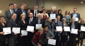 Photo of school board trustees holding OCSTA awards