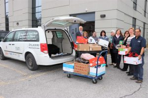 Photo of staff loading a van full of goods