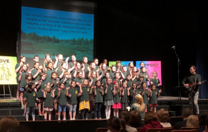 Photo of students from St. Daniel School singing on a stage.