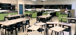 Photo of empty classroom with desks