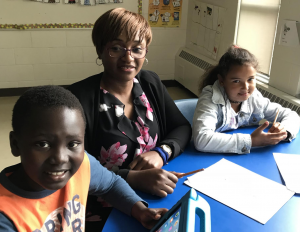 Photo of OCSB teacher Yvette Mouafo Soh with two students