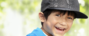 Photo of boy in baseball cap smiling