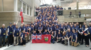 Team Ontario students gather for group photo and smile at camera
