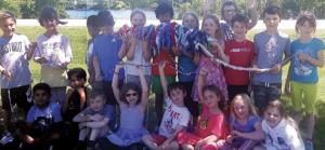 Photo of kids holding up finger-knitting rope