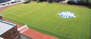 Photo of turf field with Immaculata logo on it