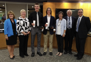 Photo of OCSB officials standing with student trustees in Boardroom
