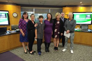 Left to right: Colleen Loubser, teacher; Renee Corrigan, teacher; Julian Fuenzalida, student; Jeannie Wong, teacher; Sheri Stashick, principal; Mark D. Mullan, Chairperson; and Mark Monahan, Executive Director-Bluesfest.
