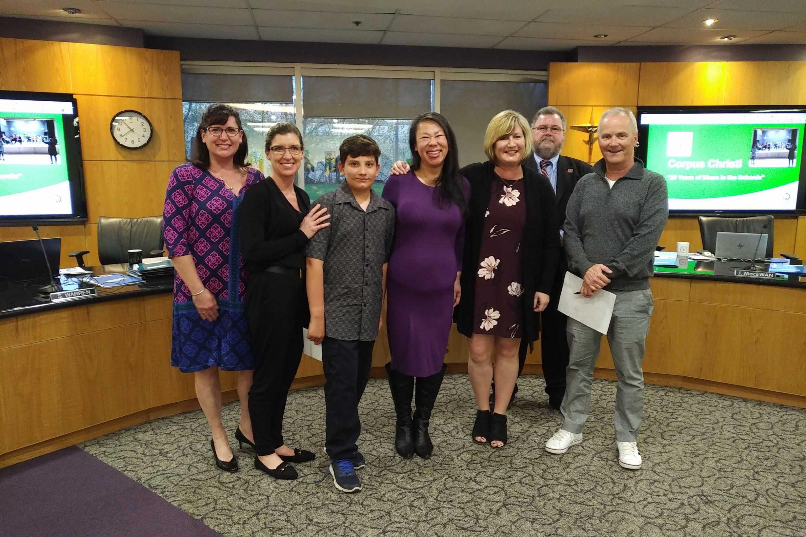 Left to right: Colleen Loubser, teacher; Renee Corrigan, teacher; Julian Fuenzalida, student; Jeannie Wong, teacher; Sheri Stashick, principal; Mark D. Mullan, Chairperson; and Mark Monahan, Executive Director-Bluesfest.