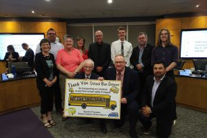 OCSB Trustees posing with a poster of support in honour of Bus Driver Appreciation Day