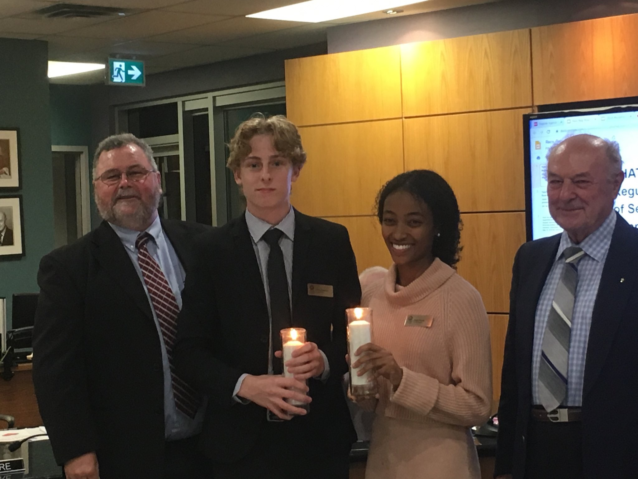 Left to right: Board Chairperson Mark Mullan, Student Trustees Sangni Kuma and Carlos Sanchez, and Board Chaplain Fr. Peter Sanders