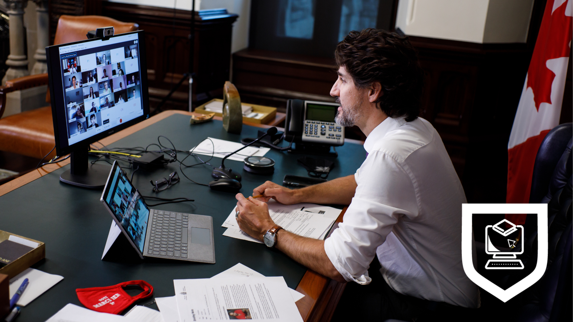 Prime Minister Trudeau chatting with students virtually on his laptop