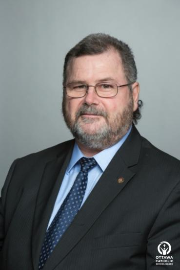 Mark D. Mullan, Chairperson