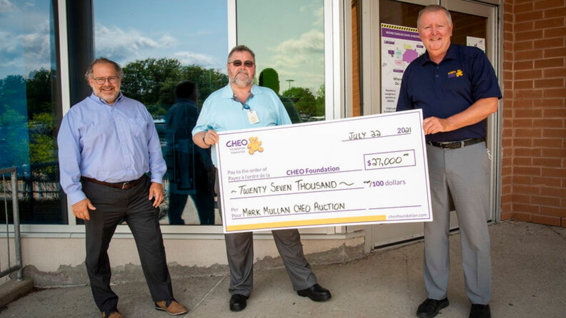 Mark mullen presenting cheque to CHEO foundation